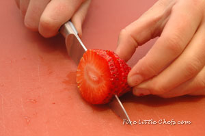 Little Chef A cutting strawberries