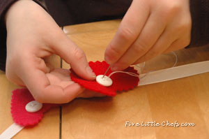C sewing on a button