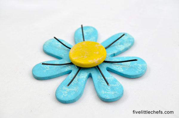 DIY Flowers with Wood and Wire Art is one of those crafts that has multiple uses. Make a magnet, attach it to a frame for diy gifts or many other ideas.