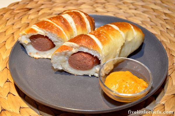 Pretzel dogs is a recipe for kids and adults. It is one of those dinner recipes that my kids frequently request. In the summer my kids help make these.