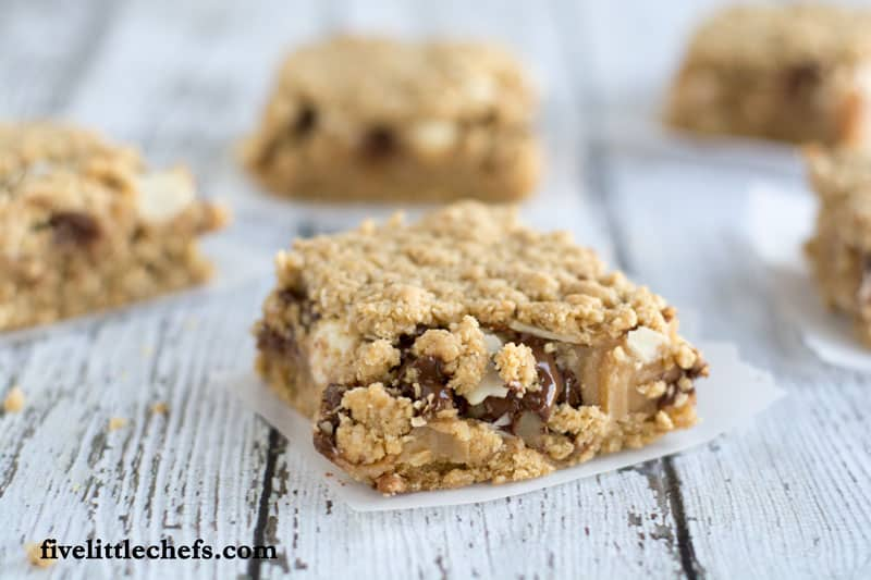 Oatmeal Chocolate Chip Peanut Butter Bars on fivelittlechefs.com is a perfect to serve at a BBQ or fun gathering. This recipe is a tasty treat the will vanish quickly!